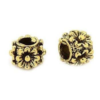 Guld perle med blomster 9 / 5 mm