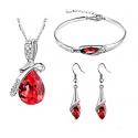 Smykkesæte med røde krystaller